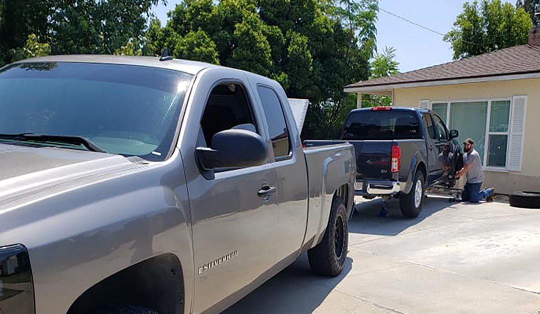 One of our mechnics working on a truck at a residence in Bakersfield CA